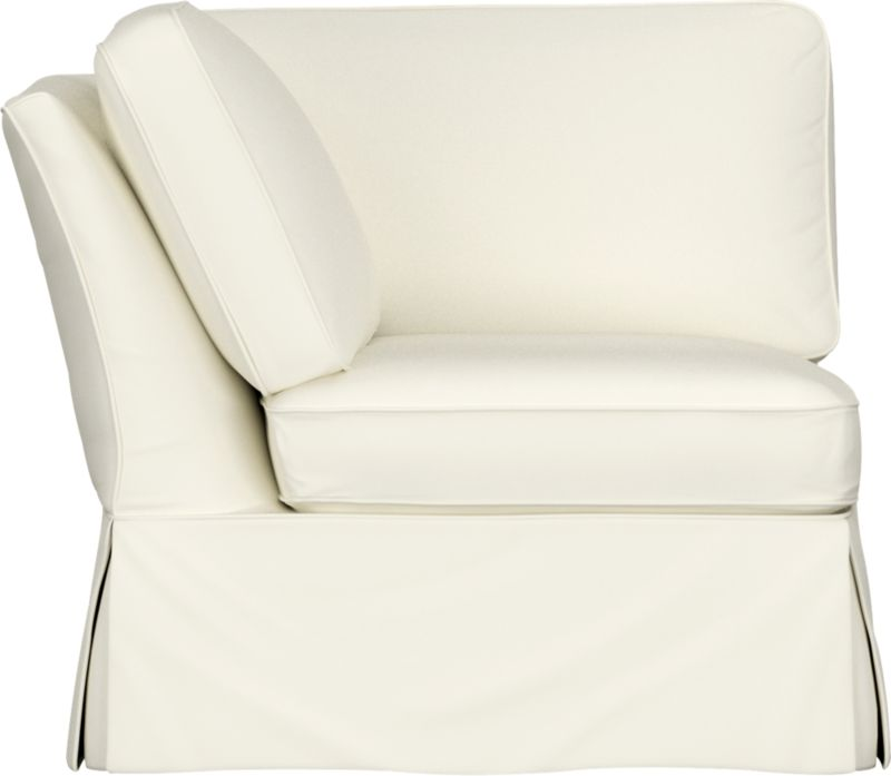 "Machine-washable skirted slipcover tailored for Bayside Corner takes on everyday living.<br /><br />Additional <a href=""http://crateandbarrel.custhelp.com/cgi-bin/crateandbarrel.cfg/php/enduser/crate_answer.php?popup=-1&p_faqid=125&p_sid=DMUxFvPi"">slipcovers</a> available below and through stores featuring our Furniture Collection.<br /><br />After you place your order, we will send a fabric swatch via next day air for your final approval. We will contact you to verify both your receipt and approval of the fabric swatch before finalizing your order.<br /><br /><NEWTAG/><ul><li>89% cotton, 11% polyester</li><li>Machine washable</li></ul><br />"