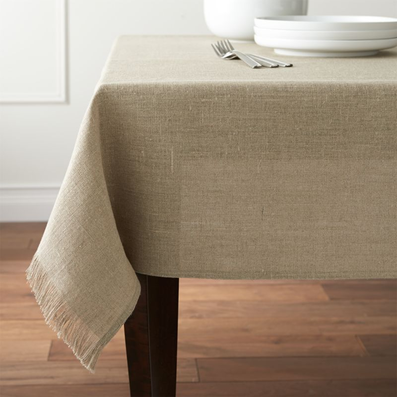 Pure, natural linen tablecloth lends a classic look and easy-going attitude to the table. Square tablecloth drapes beautifully, ending in a delicate gesture of handmade fringe.<br /><br /><NEWTAG/><ul><li>100% linen</li><li>Dry clean only</li><li>Made in India</li></ul>