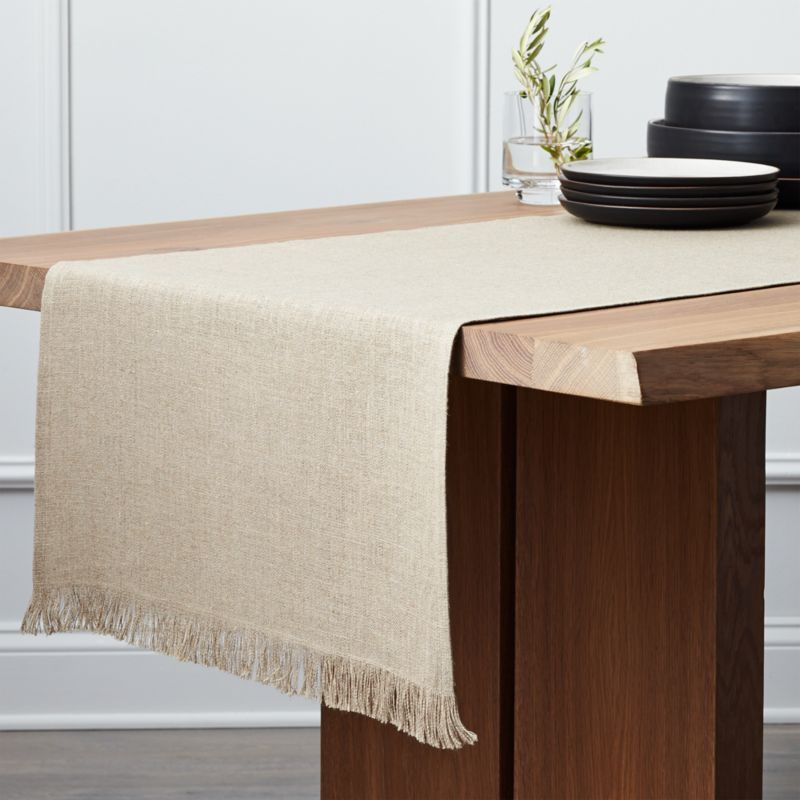 Pure, beautiful linen table runner graces the chic, casual table in natural fiber, edged with hand-made fringe.<br /><br /><NEWTAG/><ul><li>100% linen</li><li>Dry clean only</li><li>Made in India</li></ul>