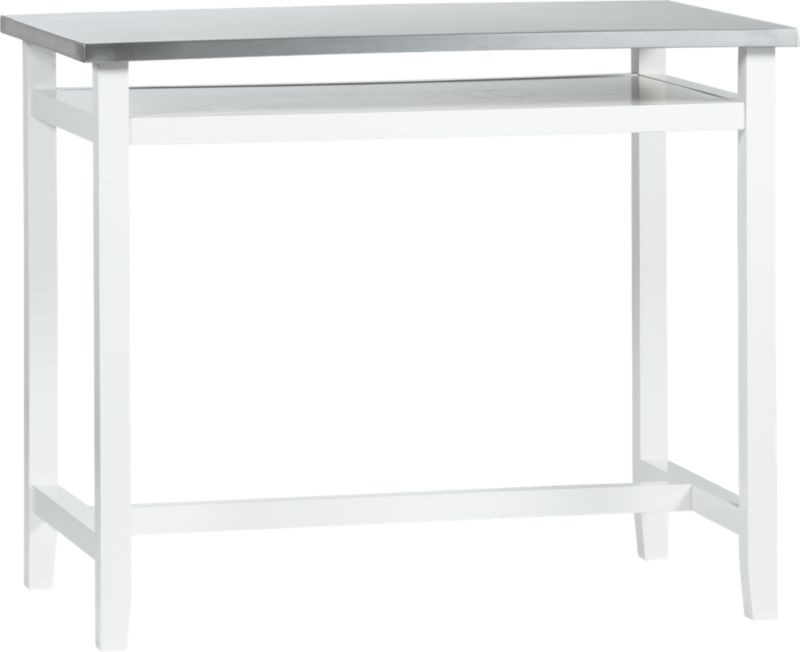 """Stainless steel is the professional chef's choice for its high function and low maintenance. And now it's our choice to top this contemporary counter-height table, sleek and clean with a white lacquered trestle base of sustainable rubberwood. Minimalist design with open storage shelf takes on kitchen prep, dining, bartending, even office work.<br /><br /><NEWTAG/><ul><li>Stainless steel top</li><li>Sustainable solid rubberwood frame with white lacquer finish</li><li>Shelf is low-emission engineered wood with rubberwood veneer and white lacquer finish</li><li>Accommodates counter stools with 24""""H seats</li><li>Seats four</li><li>Made in Thailand</li></ul>"""