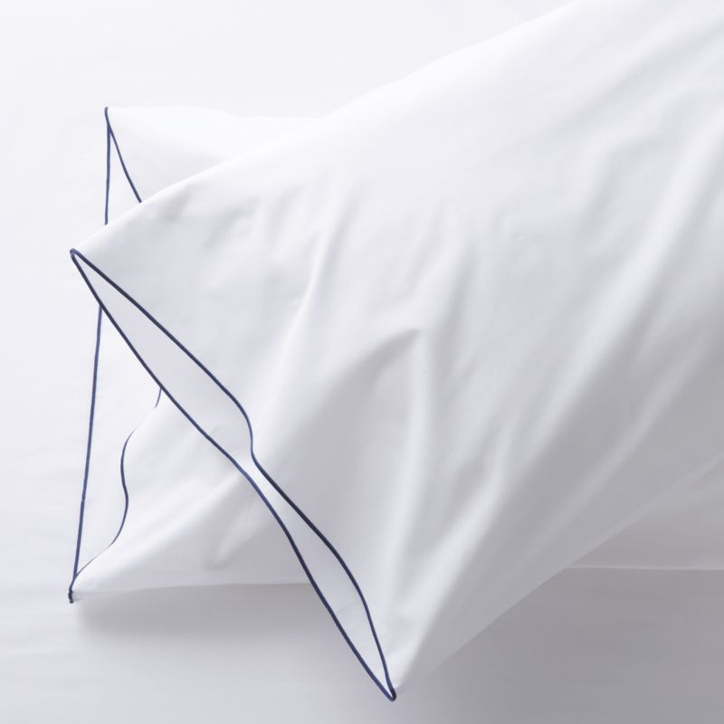 Clean, basic white bedding upgrades in soft, smooth cotton percale, beautifully contrasted with a graceful blue overlocking stitch on the flat sheet and pillow case. Bed pillows also available.<br /><br />This product is certified by Oeko-Tex®, an international association focused on textile safety and sustainable production. Oeko-Tex® tests for known harmful substances and chemicals as well as for acidity and color fastness. All components of the product must comply with stringent Oeko-Tex® standards to achieve certification.<br /><br /><NEWTAG/><ul><li>Certified by Oeko-Tek</li><li>100% cotton percale</li><li>200-thread-count</li><li>Machine wash; tumble dry low</li><li>Made in Portugal</li></ul>