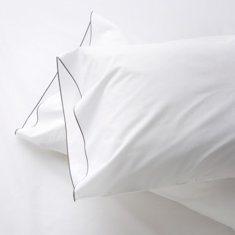 Clean, basic white bedding upgrades in soft, smooth cotton percale, beautifully contrasted with a graceful grey overlocking stitch on the flat sheet and pillow case. Bed pillows also available.<br /><br />This product is certified by Oeko-Tex®, an international association focused on textile safety and sustainable production. Oeko-Tex® tests for known harmful substances and chemicals as well as for acidity and color fastness. All components of the product must comply with stringent Oeko-Tex® standards to achieve certification.<br /><br /><NEWTAG/><ul><li>Certified by Oeko-Tex</li><li>100% cotton percale</li><li>200-thread-count</li><li>Machine wash; tumble dry low</li><li>Made in Portugal</li></ul>