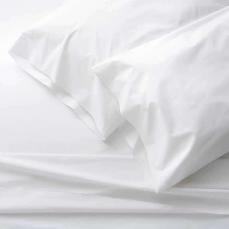 Clean, basic white bedding upgrades in soft, smooth cotton percale, beautifully accented with a graceful overlocking embroidery stitch on the flat sheet and pillow case. Generous fitted sheet pockets accommodate thicker mattresses. Sheet set includes one flat sheet, one fitted sheet and two king pillow cases. Bed pillows also available.<br /><br />This product is certified by Oeko-Tex®, an international association focused on textile safety and sustainable production. Oeko-Tex® tests for known harmful substances and chemicals as well as for acidity and color fastness. All components of the product must comply with stringent Oeko-Tex® standards to achieve certification.<br /><br /><NEWTAG/><ul><li>Certified by Oeko-Tex</li><li>100% cotton percale</li><li>200-thread-count</li><li>Machine wash; tumble dry low</li><li>Made in Portugal</li></ul>