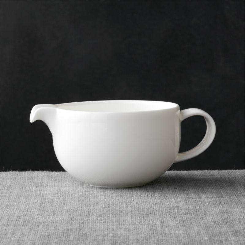 The traditional quality and translucence of fine white bone china are reinterpreted for the modern table by designer Martin Hunt as a pristine, contemporary coupe-shaped sugar bowl and creamer that dress up or down. Bennett dinnerware also available.<br /><br /><NEWTAG/><ul><li>Bone china</li><li>10 oz.</li><li>Designed by Martin Hunt</li><li>Dishwasher-, microwave- and oven-safe to 350 degrees</li><li>Made in Bangladesh</li></ul>