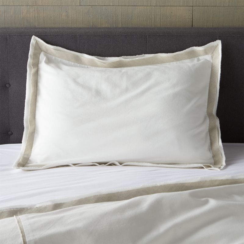 Linen and cotton seam up as neutral naturals with a modern edge. White shams are framed in a natural flange with frayed for a casual, artisanal feel. Bed pillows also available.<br /><br /><NEWTAG/><ul><li>Base fabric is 88% Cotton and 12% Linen</li><li>Decorative fabric is 52% linen and 48% cotton</li><li>Envelope closure</li><li>Machine wash cold, tumble dry low</li><li>Professional Dry Cleaning recommended for best results</li><li>Made in India</li></ul>