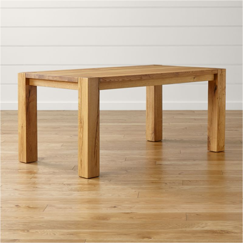 """Our bold, rustic Big Sur 65"""" dining table is all about the sheer raw beauty of nature. Each organic piece of solid European white oak reveals its family tree, with legs crafted of a single piece of heartwood—the strongest part of the tree—exposing the trunk's inner rings. <NEWTAG/><ul><li>Solid European white oak with wax finish</li><li>Peg detailing</li><li>Naturally occurring splits, cracks and knots</li><li>Solid heartwood legs</li><li>Seats 6</li><li>Made in Poland</li></ul><br />"""