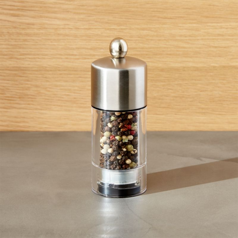 Stylish seasoning for the kitchen or table. Top has a beautiful brushed finish and friendly knob detail.<br /><br /><NEWTAG/><ul><li>Stainless and acrylic</li><li>Adjustable carbon steel grinding mechanism (not for use with salt)</li><li>Made in China</li></ul>