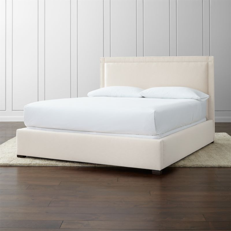 A square sensibility with architectural polish defines our Border California king bed. The linear frame is upholstered in a soft neutral cotton-poly blend. <NEWTAG/><ul><li>Frame is benchmade with certified sustainable hardwood that's kiln-dried to prevent warping</li><li>Soy-based polyfoam cushioning</li><li>Solid maple legs with brown finish</li><li>3 metal slats with 3 center support legs</li><li>Accommodates mattress and box spring (sold separately)</li><li>Maximum weight capacity: 800 lbs. (includes weight of mattress, box spring and occupants)</li><li>Made in North Carolina, USA</li></ul>