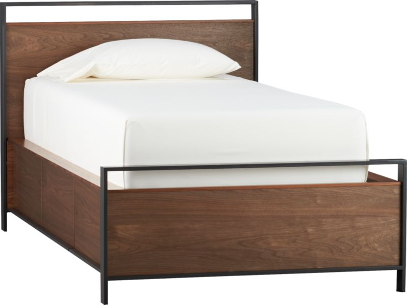Linear urban modern design combines bed and dresser in one ingenious piece. Defined by clean lines and mixed material construction in warm walnut and metal, this stylistically versatile twin storage bed offers generous built-in storage—the equivalent of a three-drawer dresser. Open metal frame outlines walnut head- and footboard in minimalist fashion and blends seamlessly with integrated drawer pulls that disappear into the frame. Continuous grain walnut veneer drawer fronts continue the illusion. Platform bed is designed for use with mattress; no foundation required. Mattresses and optional bunky board available, sold separately.<br /><br /><NEWTAG/><ul><li>Solid walnut, walnut veneer, engineered wood and metal tubing</li><li>Melamine and engineered wood drawer boxes</li><li>Plywood slat system with support legs</li><li>Platform bed designed for use with mattress; no foundation required</li><li>Maximum weight capacity: 350 pounds (includes weight of mattress, optional foundation, occupants)</li><li>Three drawers with metal ball bearing side mount drawer guides</li><li>Drawers can be assembled to open on left or right side of bed</li><li>Made in Taiwan</li></ul>