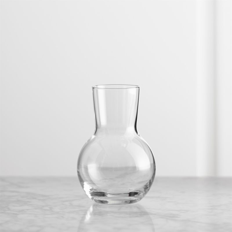 Petite vase charms with subtle curves, perfectly sized to showcase a single stem. Endlessly versatile alone or in multiples as room accents or creative tablescapes.<br /><br /><NEWTAG/><ul><li>Glass</li><li>Hand wash</li><li>Made in Poland</li></ul>