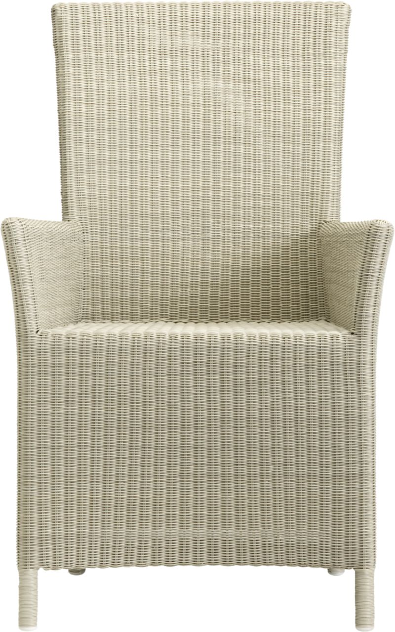 "A new dining dress code. All-weather wicker with a seaside white finish ""slipcovers"" a powdercoated aluminum frame that can move from the dining room to the patio and back again. Clean-lined, comfortable arm chair has gently curved armrests, generous seat and high, angled back.<br /><br /><NEWTAG/><ul><li>Resin wicker</li><li>Aluminum frame with powdercoat finish</li><li>Synthetic webbing</li><li>Made in Indonesia</li></ul><br />"