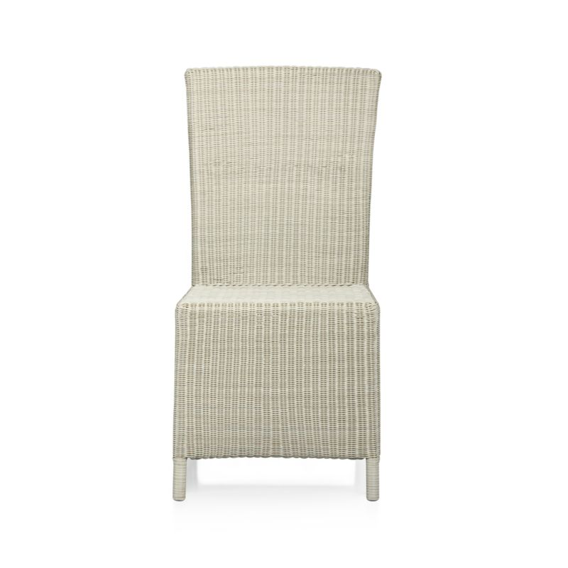 "A new dining dress code. All-weather wicker with a seaside white finish ""slipcovers"" a powdercoated aluminum frame that can move from the dining room to the patio and back again. Clean-lined, comfortable side chair has a generous seat and high, angled back.<br /><br /><NEWTAG/><ul><li>Resin wicker</li><li>Aluminum frame with powdercoat finish</li><li>Synthetic webbing</li><li>Made in Indonesia</li></ul>"