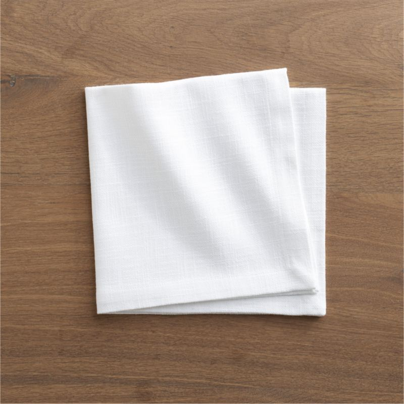 Crisp, white, 100% cotton napkin layers the table with nubby texture and beautiful drape.<br /><br /><NEWTAG/><ul><li>100% cotton</li><li>Machine wash, tumble dry; warm iron as needed</li><li>Made in India</li></ul>