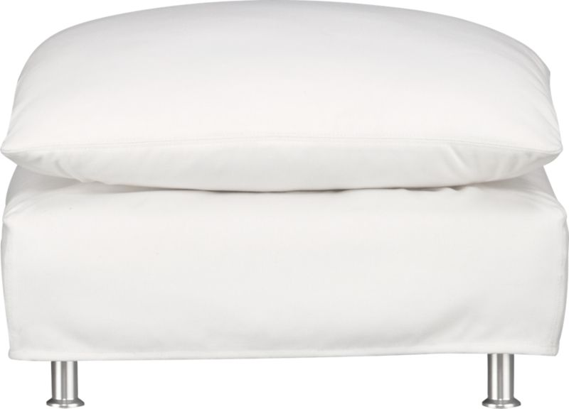 This sleek white slipcovered ottoman looks like it could be right at home in a modern urban loft. But don't bother to come inside—our eco-friendly Catalina collection is designed to live carefree outdoors under blue skies. Under that UV-, fade- and moisture-resistant Sunbrella® sailcloth slipcover (yes, it's even machine-washable), you'll find a thoughtfully crafted chair with a 15-ply outdoor-grade sustainable birch plywood frame made in the USA at the same furniture workshop as many of our living room upholstered collections. Plush cushion is a reticulated open-cell foam that allows water to drain. Upholstered in Sunbrella base cloth sand, an open-weave fabric that accelerates drainage and allows cushion to breath, with a bottom zipper to drain water and release moisture.<br /><br />After you place your order, we will send a fabric swatch via next day air for your final approval. We will contact you to verify both your receipt and approval of the fabric swatch before finalizing your order.<br /><br /><NEWTAG/><ul><li>Eco-friendly construction</li><li>Outdoor-grade sustainable birch plywood frame</li><li>Cushion is mildew-resistant, reticulated open-cell foam</li><li>Slipcovered in 100% Sunbrella solution-dyed acrylic</li><li>Machine wash the removable slipcovers; line dry</li><li>Rustproof brushed aluminum legs</li><li>See additional frame options below</li><li>Made in USA</li></ul>