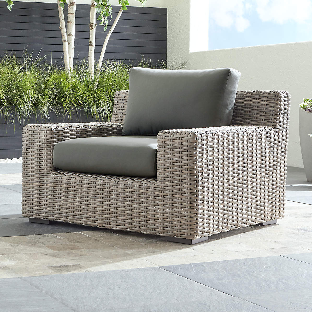 Picture of: Cayman Outdoor Lounge Chair With Graphite Sunbrella Cushions Reviews Crate And Barrel