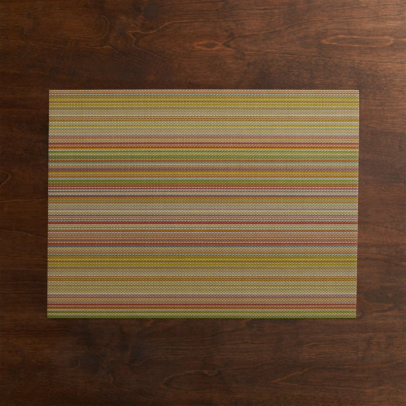 Durable polyester-vinyl placemat textures the table in an exclusive pattern of earthy tones and brights that takes its cue from finely woven textiles.<br /><br /><NEWTAG/><ul><li>70% vinyl and 30% polyester</li><li>Clean with a damp cloth; air or towel dry and store flat</li><li>Made in USA</li></ul>