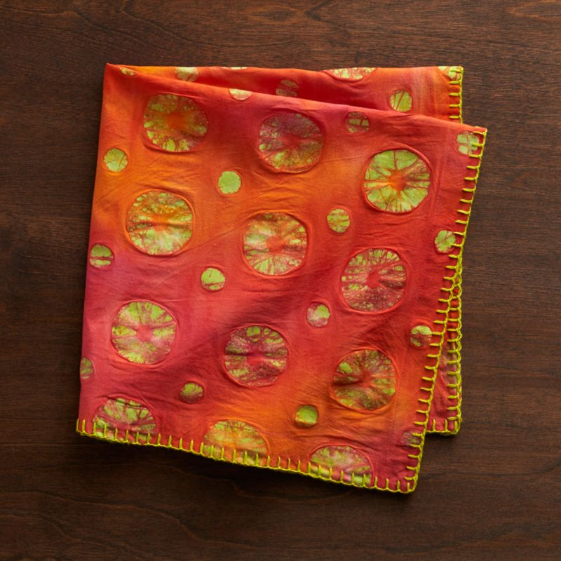 Strikingly napkin scatters intricately patterned dots on tonal, hand-batiked backgrounds of bright-bright color, bordered in contrasting trim. Whipstitched border adds even more visual texture.<br /><br /><NEWTAG/><ul><li>Handcrafted</li><li>100% cotton</li><li>Do not bleach or dry clean</li><li>Machine wash cold, tumble dry; warm iron as needed</li><li>Made in India</li></ul>