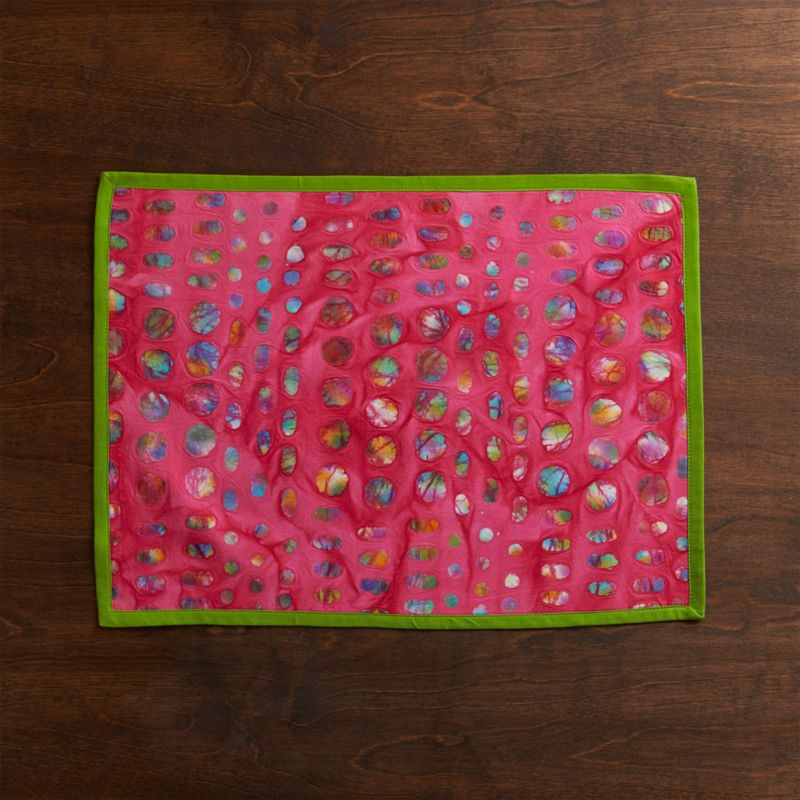 Strikingly placemat scatters intricately patterned dots on tonal, hand-batiked background of bright-bright color, bordered in contrasting trim.<br /><br /><NEWTAG/><ul><li>Handcrafted</li><li>100% cotton</li><li>Do not bleach or dry clean</li><li>Machine wash cold, tumble dry; warm iron as needed</li><li>Made in India</li></ul>