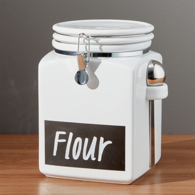 """Modern classics in white stoneware feature clean lines, airtight clamp closures to ensure freshness, convenient nested scoops, and now a """"chalkboard"""" strip to label the contents.<br /><br /><NEWTAG/><ul><li>Stoneware with rubber gaskets</li><li>Stainless steel scoops</li><li>Erasable chalkboard strip</li><li>Hand wash</li><li>Made in China</li></ul>"""