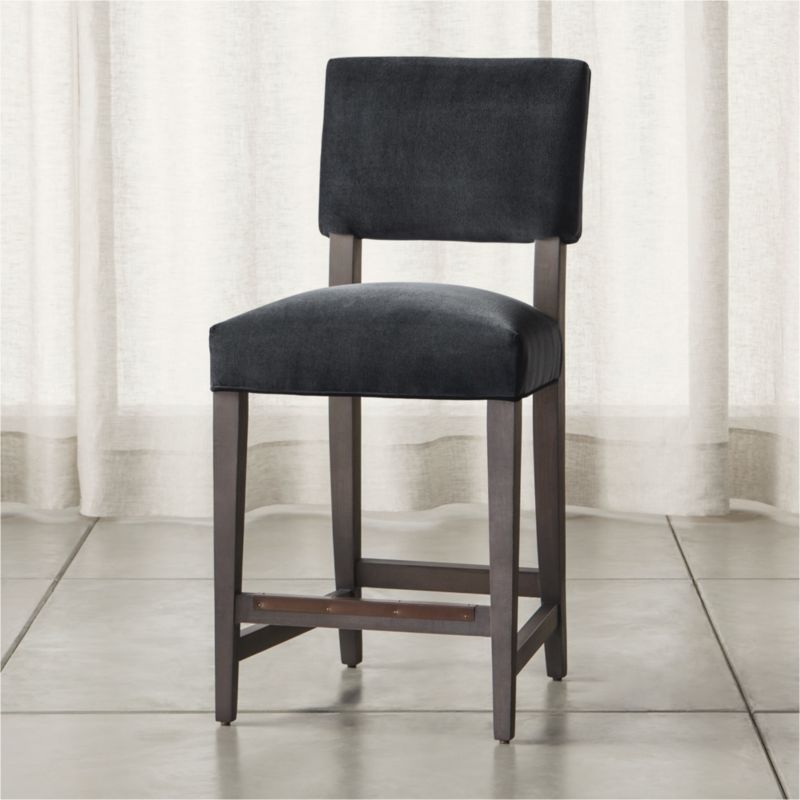 Cody receives your guests with all the generous proportions and comfort of a fully upholstered dining chair, but keeps the room light and airy with its open back design and minimal lines.  <NEWTAG/><ul><li>Certified sustainable hardwood frame with grey finish</li><li>Synthetic webbing suspension</li><li>Plant-based foam tight seat and back cushions</li><li>Made in North Carolina, USA</li></ul><br /><br />