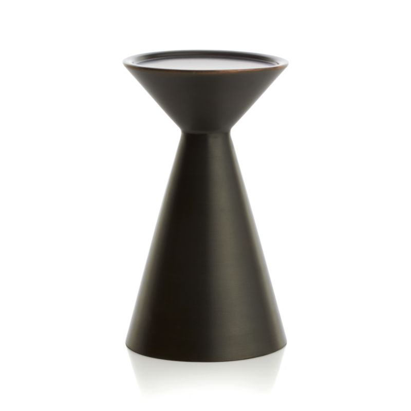 """Iconic meets conic in stylized spool-designed candleholder with a mid-century modern vibe. Clean, contemporary pedestal of darkly lustrous iron is a versatile decor accent on its own or grouped with other candleholders in the Cohen collection.<br /><br /><NEWTAG/><ul><li>Iron</li><li>Accommodates up to 3""""-dia. pillar candle, sold separately</li><li>Dust with soft dry cloth</li><li>Made in India</li></ul>"""