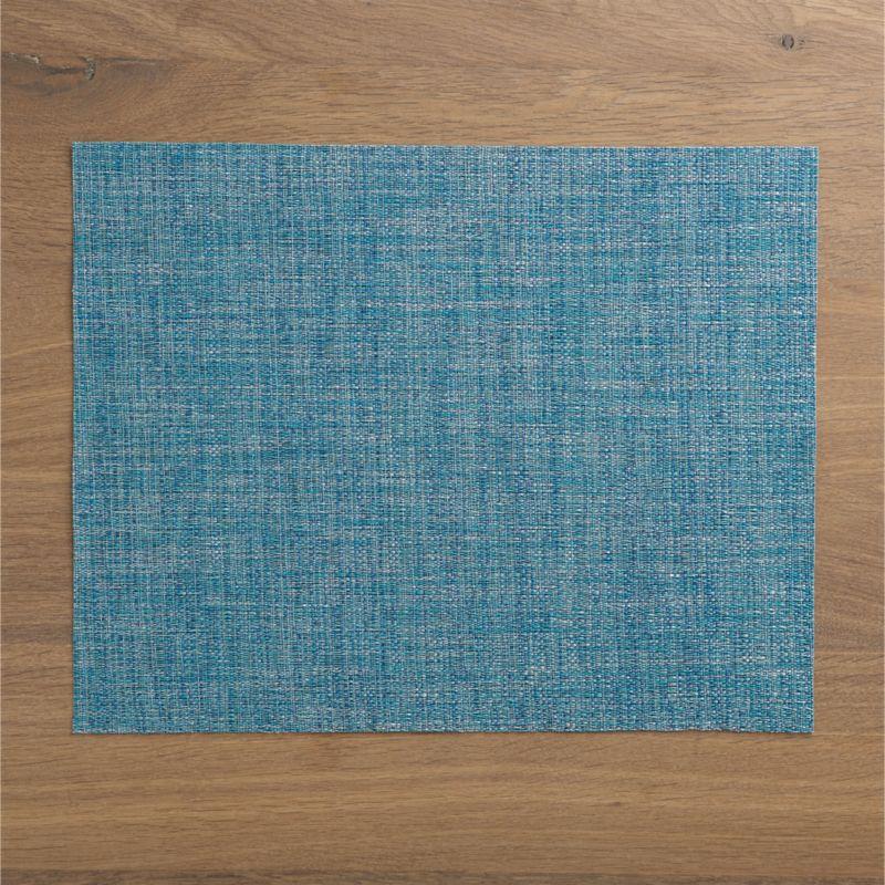 Tonal weave of easy-care vinyl adds a pop of textured color to the table.<br /><br /><NEWTAG/><ul><li>100% woven vinyl</li><li>Hand wash</li></ul>