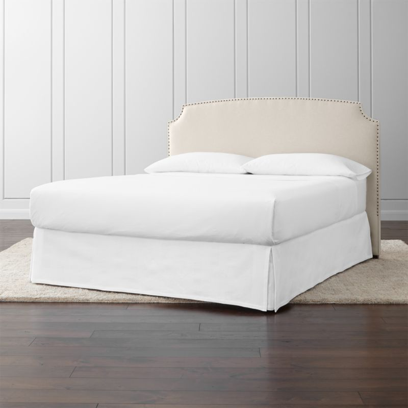 With an alluring shape, classic styling and graceful corner arcs, the Curve California king headboard stays ahead of the curve with lines that carve an element of drama into the sleek profile. <NEWTAG/><ul><li>Frame is benchmade with certified sustainable hardwood that's kiln-dried to prevent warping</li><li>Soy-based polyfoam cushioning</li><li>Solid maple legs have a brown finish</li><li>Headboard requires a bed frame (sold separately)</li><li>When attached to Crate and Barrel bed frame no additional hardware required; accommodates mattress and box spring (sold separately)</li><li>Non-Crate and Barrel bed frame may require a Modi-Plate Kit (sold separately)</li><li>Made in North Carolina, USA</li></ul>