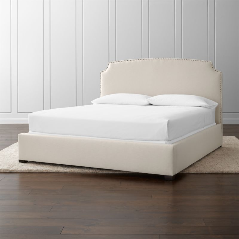 """With its clean, classic styling, alluring curves and graceful corner arcs, the Curve king bed features lines that carve an element of drama into its sleek profile. <NEWTAG/><ul><li>Frame is benchmade with certified sustainable hardwood that's kiln-dried to prevent warping</li><li>Soy-based polyfoam cushioning</li><li>Solid maple legs have an brown finish</li><li>3 metal slats with 3 center support legs</li><li>Accommodates <a href=""""/furniture/mattresses-foundations/1"""">mattress and box spring</a> (sold separately)</li><li>Maximum weight capacity: 800 lbs. (includes weight of mattress, box spring and occupants)</li><li>Made in North Carolina, USA</li></ul><br />"""