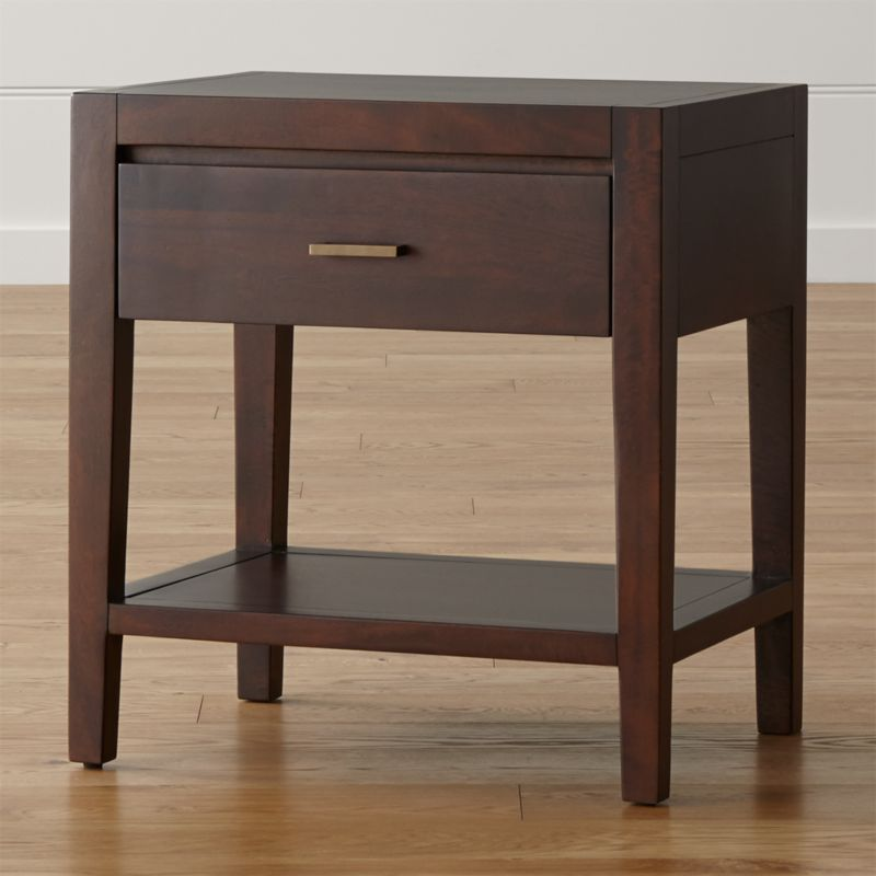 This handsome bedside companion echoes the trim, tailored lines of our Dawson collection with its richly grained solid mango wood showcased in a rich clove brown finish. Naturally occurring knots and grain add character to each nightstand, a convenient bedside spot with a fixed lower shelf and storage drawer with antique, cast brass pull. The Dawson Nightstand is a Crate and Barrel exclusive.<br /><br /><NEWTAG/><ul><li>Solid sustainable mango wood, mango veneer and engineered wood</li><li>Clove brown stain with clear lacquer finish</li><li>Naturally expands and contracts with seasonal changes in humidity</li><li>Self-closing undermount metal drawer glides</li><li>Cast brass drawer pull with antique finish</li><li>Made in Indonesia</li></ul>