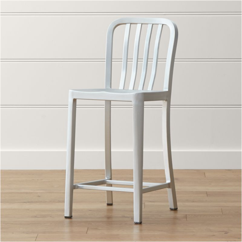 Delta features straightforward styling in pure aluminum, anodized for a sleek, durable finish. Classic, contemporary and industrial, the counter stool has a casual look that mixes well with metal, wood or glass furnishings. <NEWTAG/><ul><li>Hand-polished anodized aluminum</li><li>Cross bar</li><li>Foot caps to protect floor surfaces</li><li>Made in China</li></ul><br /><br />