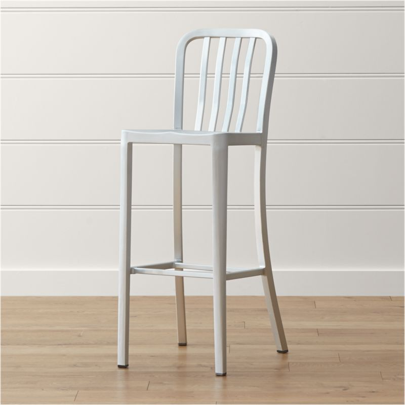 Delta features straightforward styling in pure aluminum, anodized for sleek, durable finish. Classic industrial and contemporary, the stool has a casual look that mixes well with metal, wood or glass furnishings. <NEWTAG/><ul><li>Hand-polished anodized aluminum</li><li>Cross bar</li><li>Attached caps on feet to protect floor surfaces</li><li>Made in China</li></ul><br /><br />