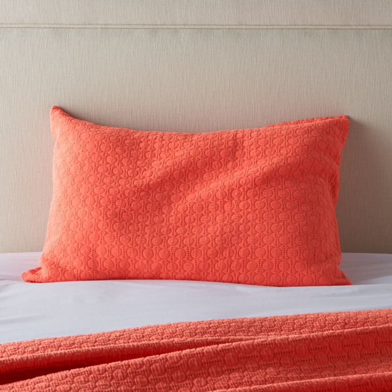 Jacquard-woven dots pepper classically elegant bed linens with subtle texture in a gorgeous shade of coral. Pairs beautifully with our Belo Coral sheet set.<br /><br /><NEWTAG/><ul><li>96% cotton and 4% polypropylene</li><li>Envelope closure</li><li>Machine wash cold, tumble dry low; warm iron as needed</li><li>Made in Portugal</li></ul><br />