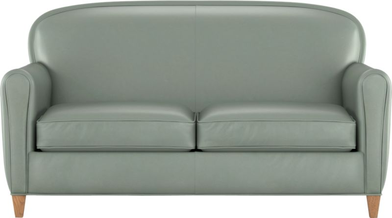Our classic French Deco leather club loveseat has all the authentic provenance of the originals, from its low seat to its quite rakish, angled back that sits deep and encourages reading every single word on every single page of the Sunday Times. A handsome welted arc at the top and slightly rounded arms are very much of the period. Oak legs finished in weathered grey are the perfect complement.<br /><br />After you place your order, we will send a leather swatch via next day air for your final approval. We will contact you to verify both your receipt and approval of the leather swatch before finalizing your order.<br /><br /><NEWTAG/><ul><li>Eco-friendly construction</li><li>US-sourced kiln dried hardwood</li><li>Seat cushions are soy-based polyfoam wrapped in regenerated synthetic fiber and encased in downproof ticking</li><li>Tight back is filled with soy-based polyfoam and regenerated synthetic fibers</li><li>Eight-way, hand-tied spring suspension with partially recycled steel</li><li>Top-grain, full-aniline leather</li><li>Solid oak legs with weathered grey finish</li><li>Benchmade</li><li>See additional frame options below</li><li>Made in North Carolina, USA</li></ul>