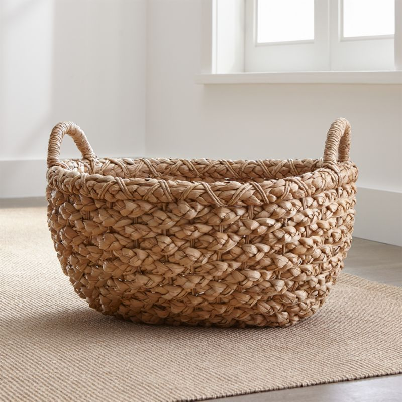 Chunky braids of rustic bankuan leaves weave a tall textural basket, ready to stow toys, towels, magazines and more. Sturdy handles are soft to the touch but strong enough for carting stored items. Casual storage option adds a warm natural touch to any room.<br /><br /><NEWTAG/><ul><li>Bankuan grass and wire</li><li>Indoor use only</li><li>Wipe with dry cloth</li><li>Made in The Philippines</li></ul>