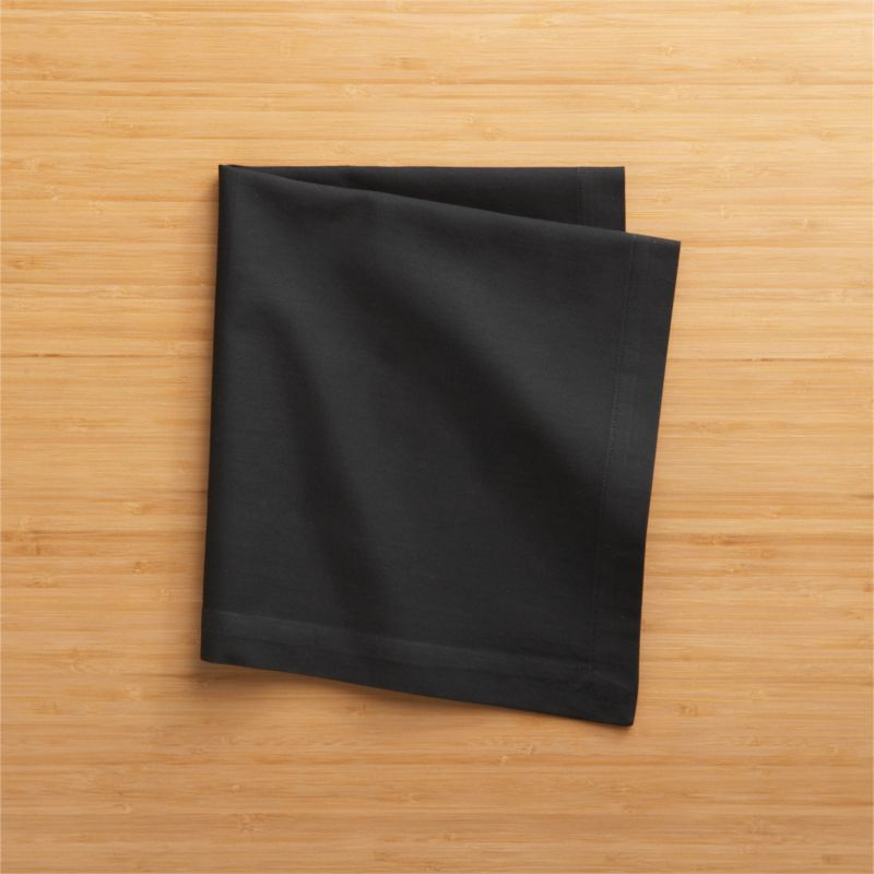"Soft cotton black cloth napkins mix and match gorgeous tones of saturated color. Elegant yet easy-care napkin is tailor finished with 1"" hem and mitered corners.<br /><br /><NEWTAG/><ul><li>100% cotton</li><li>Machine wash cold, tumble dry; warm iron as needed</li><li>Made in India</li></ul>"