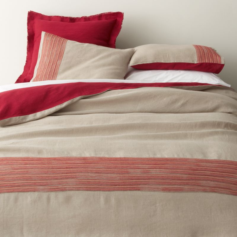 Fiery red lights up natural linen bedding with embroidered tonal bands and deep solid accents. Off-center detailing wraps the foot of the bed in colorful stripes, reversing to solid red. Duvet covers have interior ties to hold insert in place and hidden-zipper closure. Duvet inserts also available.<br /><br /><NEWTAG/><ul><li>100% linen</li><li>100% polyester embroidery</li><li>Machine wash, tumble dry low; iron damp</li></ul>