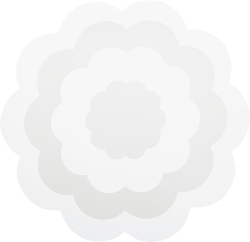 Place settings blossom on fresh floral-shape placemat. Graphic concentric flower pattern is screened in black on clear base of easy-care polypropylene. Wipes clean with damp cloth.<br /><br /><NEWTAG/><ul><li>Polypropylene placemat</li><li>Wipe placemat clean with damp cloth</li></ul><br />