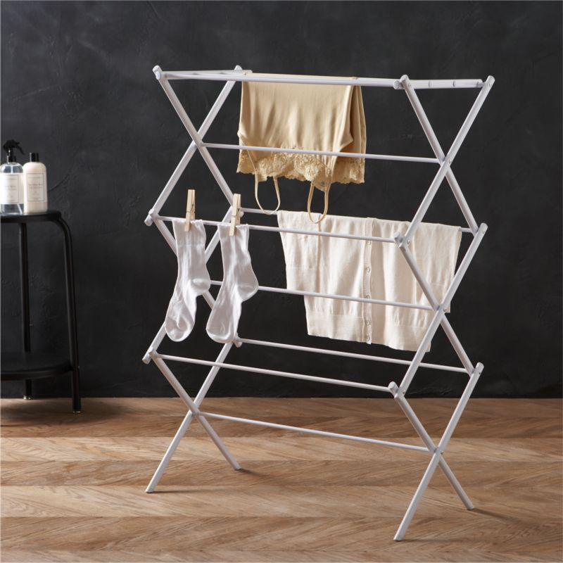 Laundry room essential in epoxy-coated steel. Rack expands to offer multiple drying rods, fold flat when not in use (see additional photos).<br /><br /><NEWTAG/><ul><li>Epoxy steel frame</li><li>40-pound capacity</li><li>Made in China</li></ul>