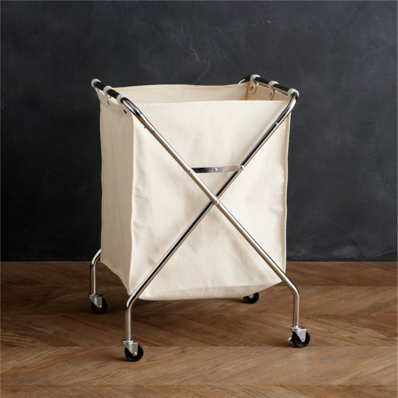 Compact, commercial-style hamper features a medium-weight cotton canvas bag that affixes to the chrome-plated steel frame with six stainless snaps. Hamper rolls on rugged industrial casters for convenience and folds up when laundry day is done.<br /><br /><NEWTAG/><ul><li>Chrome-plated steel frame</li><li>Industrial casters</li><li>100% medium-weight cotton canvas bag</li><li>Stainless steel snaps</li><li>Clean frame with a dry cloth</li><li>Machine wash cotton canvas bag</li></ul>