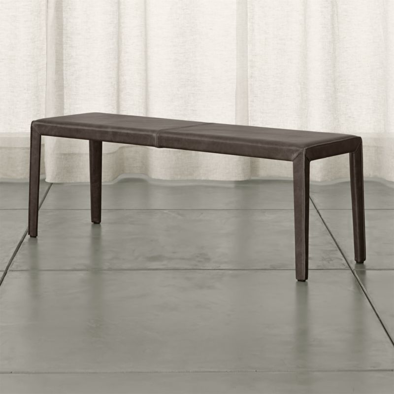 """Pull up our Folio bench to the dining table or place it anywhere you could use some extra seating with an Italian accent. Fully wrapped in top-grain, semi-aniline vegetable-tanned leather, the Folio 52"""" bench reinterprets classic Italian design with clean Parsons-style lines and refined finishing details. <NEWTAG/><ul><li>Welded steel frame</li><li>Polyfoam seat cushion with fiber wrap</li><li>Mitered cut and stitched leather</li><li>Flange seaming</li><li>Seats 2</li><li>Made in China</li></ul>"""