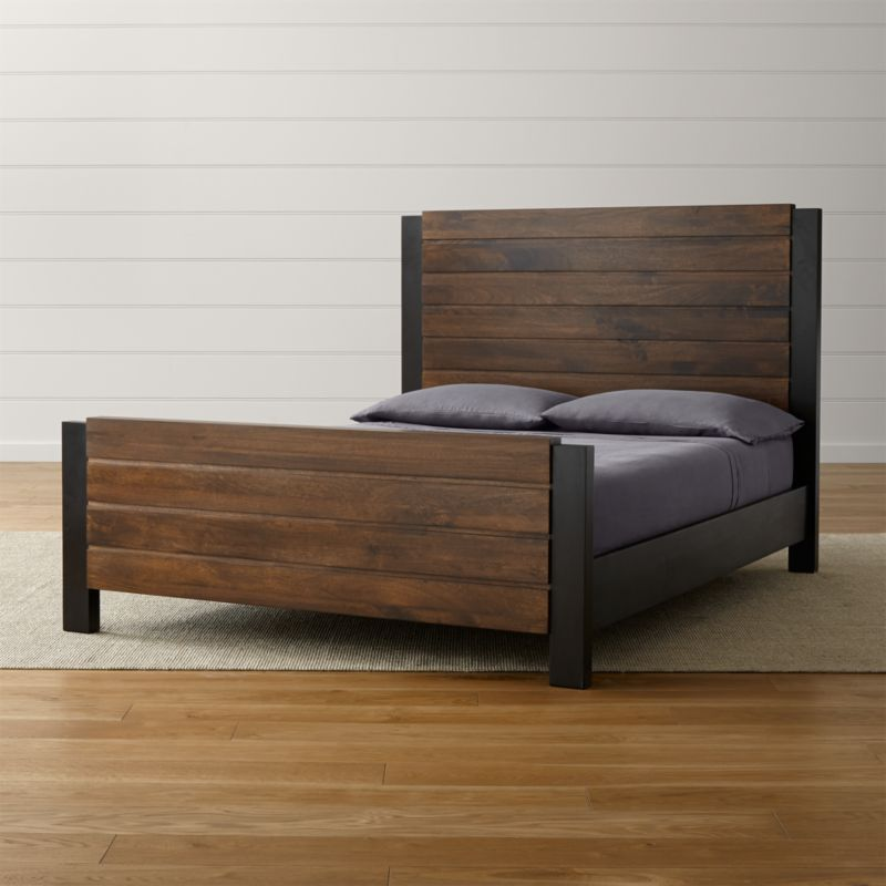 "Forsyth's clean, straightforward styling in natural mango wood brings a bold look to the bedroom in a striking two-tone mix. Deep espresso and warm tobacco enrich refined planks to bring out the wood's richly grained beauty. <NEWTAG/><ul><li>Designed by Blake Tovin of Tovin Design</li><li>Solid mango headboard and footboard with tobacco brown finish</li><li>Solid mango side rails with espresso finish</li><li>Tubular steel legs</li><li>Two sets of 15 slats and one center support leg</li><li>As with all solid woods, expansion and contraction may occur with seasonal changes in humidity</li><li>Platform bed designed for use with mattress only</li><li><a href=""/furniture/mattresses-foundations/1"">Mattresses</a> and optional <a href=/bunky-board/f30646>bunky board</a> available (sold separately)</li><li>Maximum weight capacity: 800 pounds (includes weight of mattress and occupants)</li><li>Made in India</li></ul>"