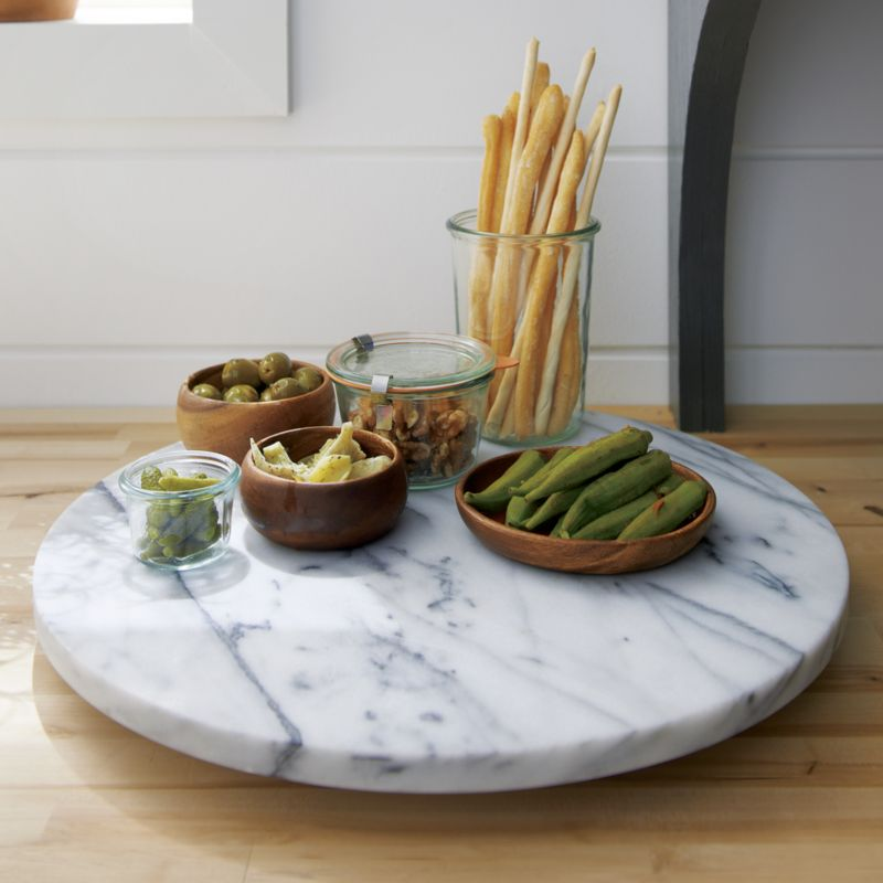 A Lazy Susan Is A Spinning Circular Serving Tray That Works Like A Turntable,  Allowing Guests Easier Access To Food, Condiments Or Beverages.