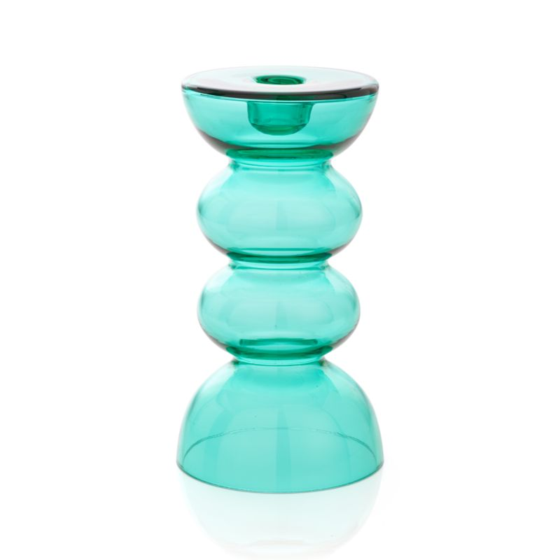 "Aquamarine curves of clear glass ebb and flow in a well-turned, artisan-crafted candleholder. Luminous on its own or couple with its companion small candleholder for a sea-inspired pairing.<br /><br /><NEWTAG/><ul><li>Handcrafted</li><li>Glass</li><li>Accommodates up to 3""-dia. pillar candle, sold separately</li><li>Dust with soft dry cloth</li></ul>"