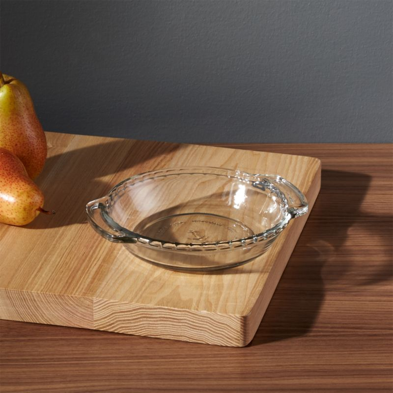 """The mini version of the American kitchen classic with fluted """"crust"""" edge from Anchor Hocking makes individual servings of pies, tarts, quiches, pot pies and casseroles. Glass bakes evenly and allows monitoring of bottom crust.<br /><br /><NEWTAG/><ul><li>Clear glass</li><li>Dishwasher-, microwave-, freezer- and oven-safe to 425 degrees</li><li>Made in USA of domestic and imported materials</li></ul>"""