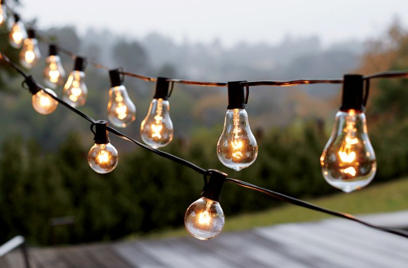 Illuminated Globe Bulb Hanging Patio String Lights Over An Outdoor Deck Part 60