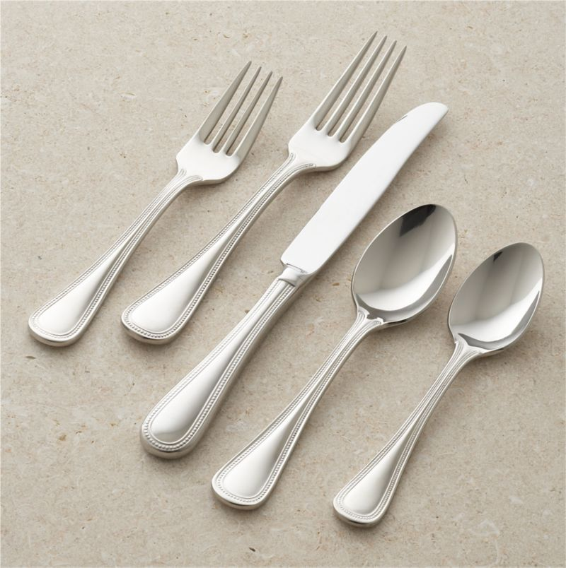 In the gracious tradition of our Grand Hotel flatware, this new version is scaled up and even more substantial in weight. The classic design features intricate beadwork accentuated with a subtle dome in the center of the handle.<br />Includes 4 5-piece placesettings.<br /><br /><NEWTAG/><ul><li>18/10 stainless steel</li><li>Mirror finish</li><li>Dishwasher safe; avoid citrus-scented detergents</li><li>Made in China</li></ul>