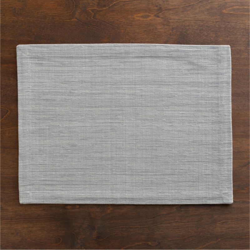 Rich hand-dyed colors in subtle tone-on-tone hues are handwoven into a grasscloth textured placemat.<br /><br /><NEWTAG/><ul><li>100% cotton</li><li>Oversized to allow for shrinkage</li><li>Machine wash, reshape and dry flat; iron while damp</li><li>Made in India</li></ul>