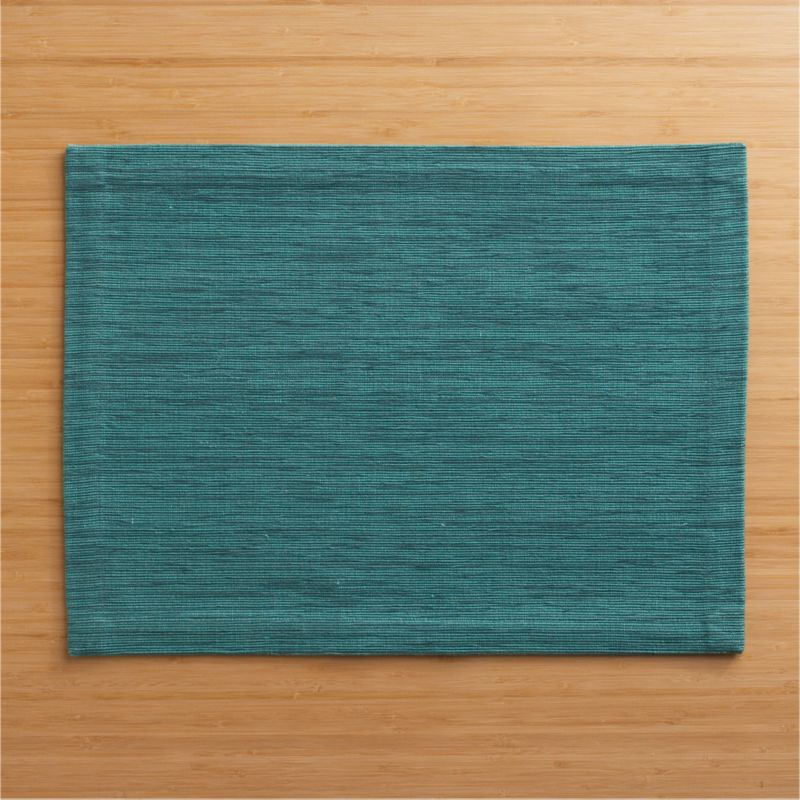 Rich hand-dyed colors in subtle tone-on-tone hues are handwoven into a grasscloth textured placemat.<br /><br /><NEWTAG/><ul><li>100% cotton</li><li>Hand-dyed and handwoven</li><li>Machine wash placemat; dry flat and iron damp</li></ul><br />
