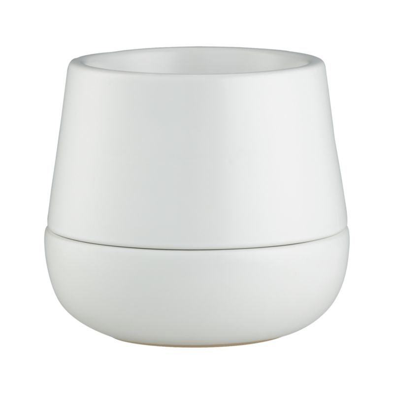 Sculptural double-walled planter in neutral stoneware blurs the boundaries between pot and saucer with its modern nested design. Deep saucer catches residual water for indoor or outdoor planting.<br /><br /><NEWTAG/><ul><li>Glazed stoneware</li><li>Hand wash</li></ul>