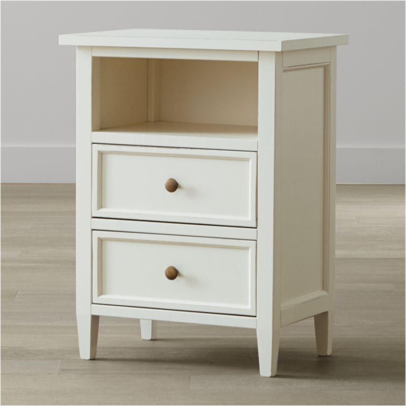 Our casual-modern bedroom collection evokes the simple pleasures of days at the shore. Handpainted in a creamy white and distressed with a warm patina by Italian master craftsmen, the Harbor nightstand has 2 drawers with contrasting sage green interiors and antique brass knobs and a convenient open storage area. <NEWTAG/><ul><li>Solid Tulip wood and Tanganyika walnut veneer over engineered wood</li><li>Hand-applied creamy white water-based paint sealed with a beeswax finish</li><li>Naturally expands and contracts with changes in humidity</li><li>Contrasting sage green finish inside drawers</li><li>Wood on wood drawer glides</li><li>Antique brass knobs</li><li>Made in Italy</li></ul>